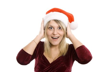 Portrait of the young blonde in a Christmas cap photo
