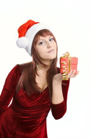 The nice brunette with a Christmas gift in hands Stock Photo - 6118088