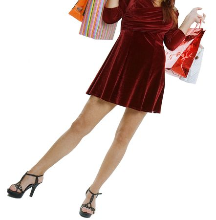 The woman in a dress with purchases in hands photo