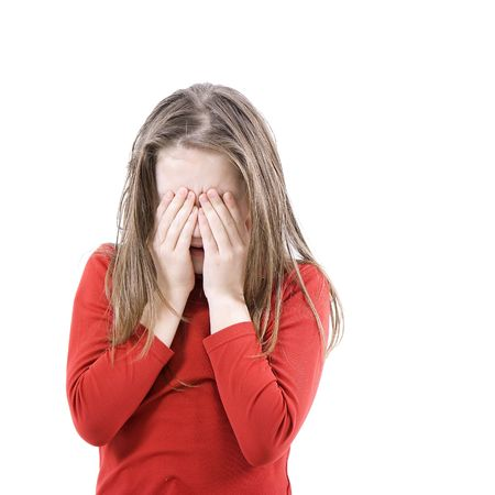 The little girl scaredly shuts the face with the hands Stock Photo - 6323317