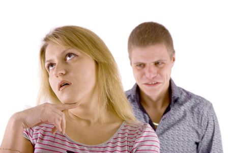 indifferent: Young couple quarrel. A man in a rage, the woman is indifferent. Stock Photo
