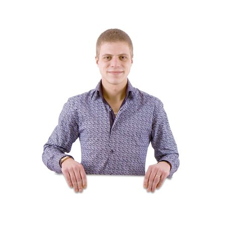 The happy young man on white background behind the white stand Stock Photo - 7202258