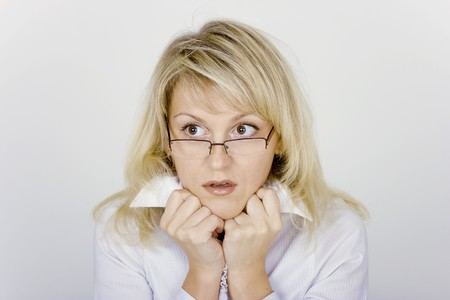 frightened business woman in glasses and a white blouse Stock Photo - 7488714