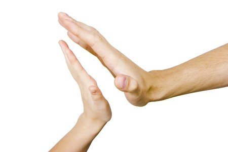 children's and men's hand touching on a white background Stock Photo - 7490585