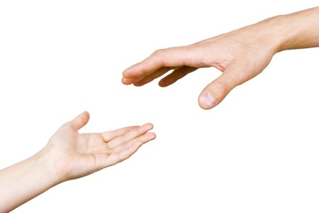 child's hand reaches for the male hand on a white background Stock Photo - 7490584