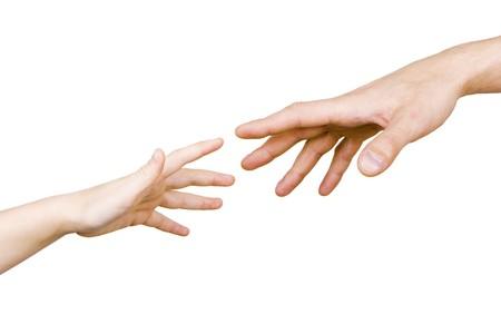 白い背景の上の男性の手のための子供の手の届く 写真素材