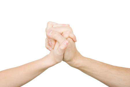 friendly handshake man and child on a white background Stock Photo - 7747357
