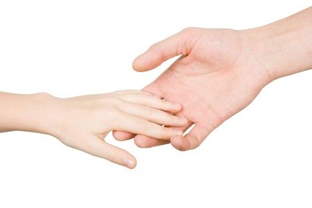 child's hand reaches for the male hand on a white background Stock Photo - 7747361