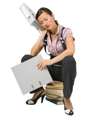 young girl sleeping on the books at an isolated white background