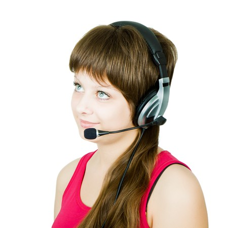 employee hotline. The girl in headphones with a microphone on an isolated white background Stock Photo - 8032117