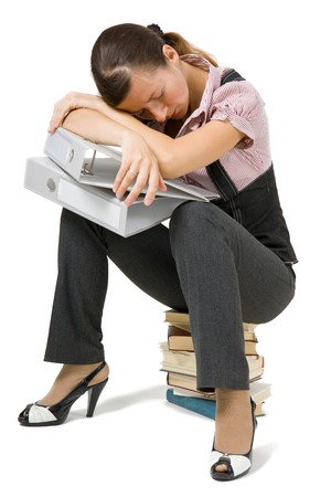 young girl asleep sitting on the books on an isolated background Stock Photo - 8032126