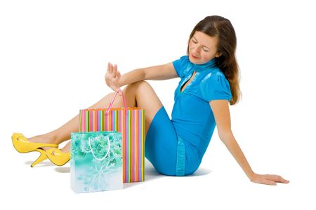 babycare: girl in a bright dress with shopping Stock Photo
