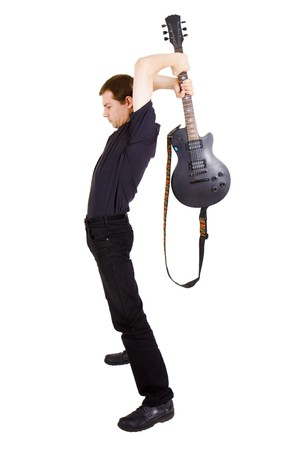 smash: Rock musician break guitar on a white background
