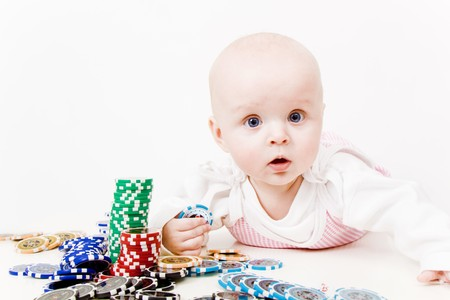 infant with chips for a casino on a white background
