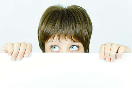 young girl hiding behind a white banner Stock Photo - 8240062