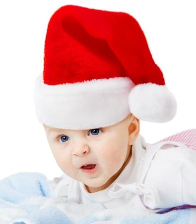 baby in a Christmas hat on a white background