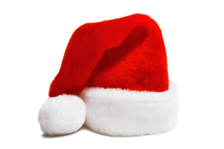 red furry Christmas hat of Santa Claus. Isolated white background
