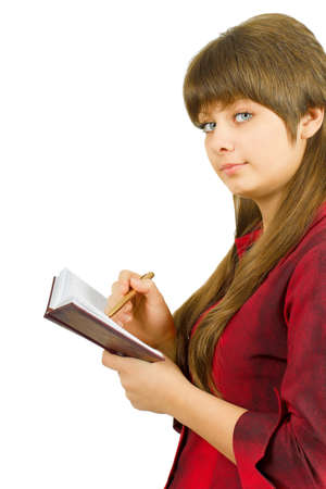 young beautiful girl with a notebook. Isolated white background  photo