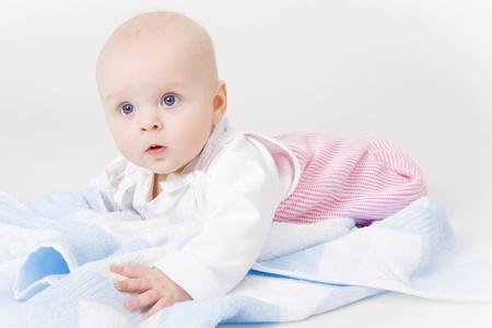 babycare: baby girl in the studio on the floor