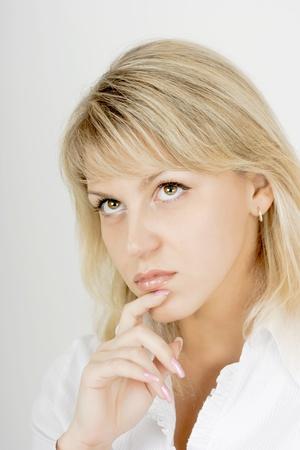 hazel eyes: portrait of a pensive girl attractive blonde with hazel eyes Stock Photo
