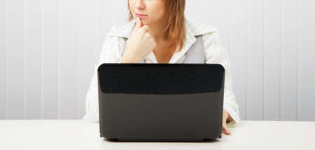 Business pensive woman with a laptop. Office scene. Stock Photo - 9072331