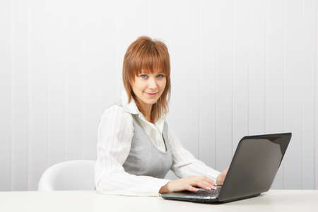 attractive girl with a computer. Business woman Stock Photo - 9072334