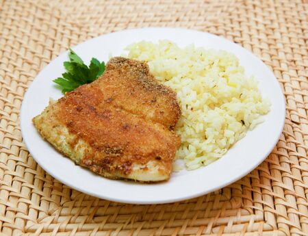 breaded: fried breaded tilapia served with rice and herbs