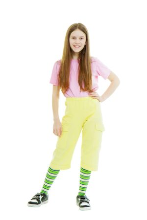 Teen girl in a bright summer clothes on the isolated white background