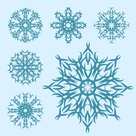 set of blue snowflakes of different shapes Vector