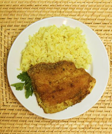 fried breaded tilapia served with rice and herbs Stock Photo - 10867170