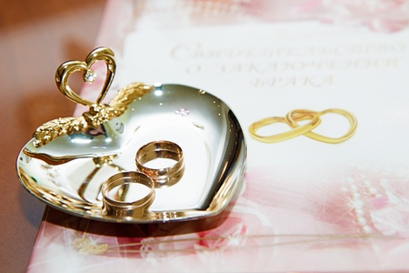 marriage certificate: wedding rings and marriage certificate to the registration desk Stock Photo