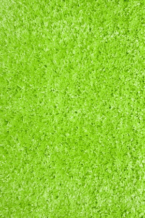 green carpet: green carpet of artificial material close-up. The texture of the carpet