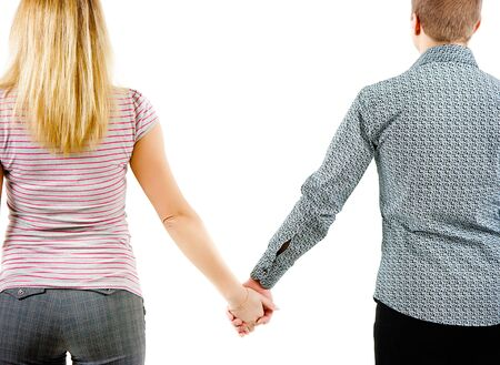 lovers holding hands: A young couple holding each other Stock Photo