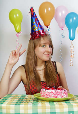 Birthday. Happy girl with balloons and cake photo