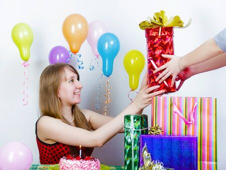 accepts: Birthday. The girl accepts gifts from friends