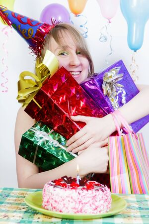 Birthday. Happy girl with lots of gifts photo