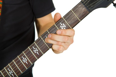 hand artist and  electric guitar neck on white background photo