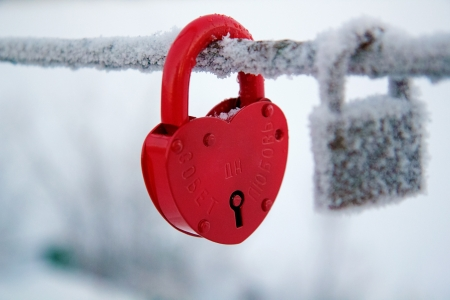 Wedding lock on a bridge covered with frost Stock Photo