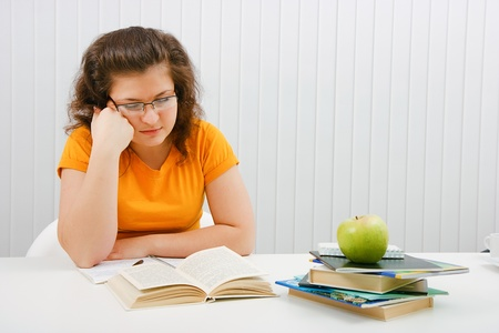 tired girl student with books and notebooks photo