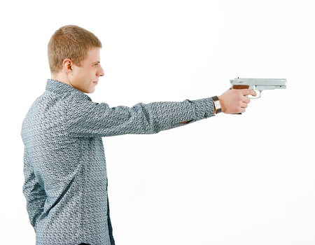 a man with a gun aiming at the distance. profile photo