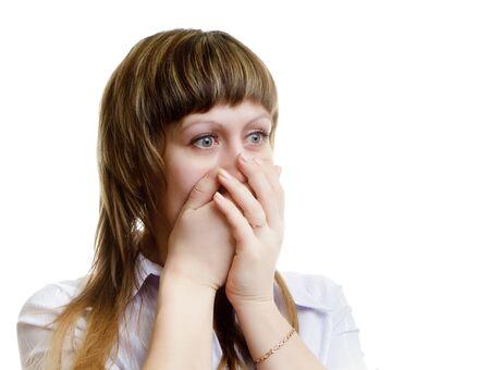 unexpectedness: asustada mujer joven en un fondo blanco Foto de archivo