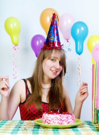 Birthday. Young fun happy girl with cake and balloons photo