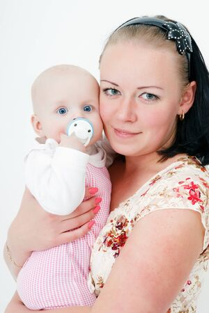 mother holding a baby daughter. studio photography photo