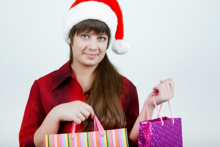 A girl in a Christmas hat with shopping Stock Photo - 14718771