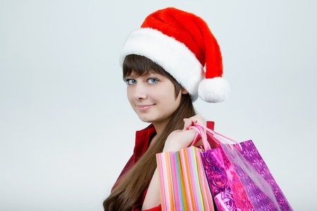 A girl in a Christmas hat with shopping Stock Photo - 14718765