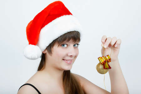 attractive girl in a Christmas hat with Christmas decorations