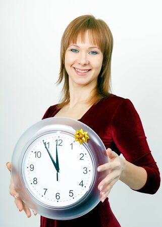 attractive girl with a clock on the eve of Christmas photo