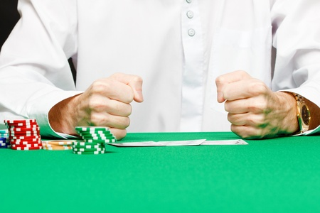 male player at the card table in the casino photo