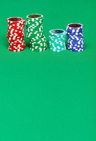 casino chips on the green gaming table photo