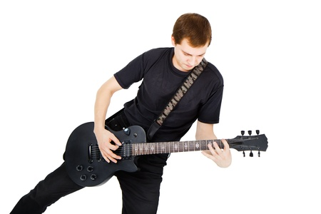 Musician with a black electric guitar on a white background photo